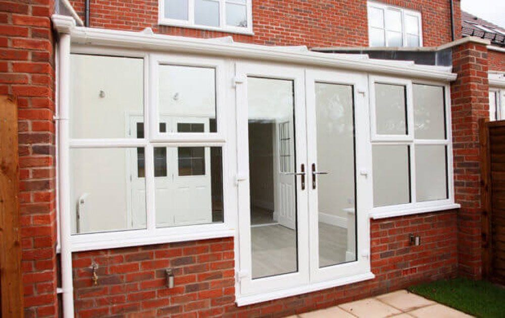 Upvc french doors derby upvc doors derby nottingham for Upvc french doors draught